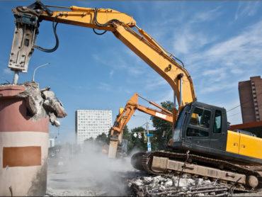 Hydraulic Crushing Hammer demolishing reinforced concrete structures